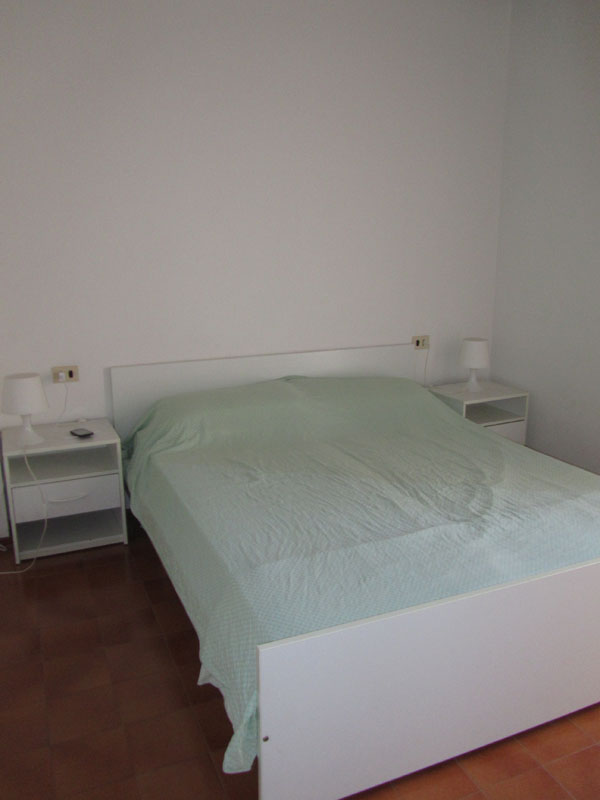 Спальня в квартире на море в Италии